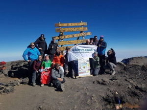 Enda O'Doherty pictured at Barafu Camp with Ireland's most famous washing machine, the day before the Pieta Challenge team reached the summit of Mount Kilimanjaro. Also pictured are the group of Pieta Challengers, including his wife Maeve, who magnificently made the peak.