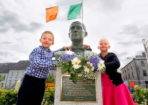 Pictured were twins Lucas and Olivia Berlinger from Switzerland, great-grandchildren of Waterford born John J Hearne, Architect of the Irish Constitution as they admire a bust erected in his honour at a ceremony outside the Bishop's Palace. Both placed a bouquet of flowers at the bust. See News 15 for more.| Photo: Noel Browne