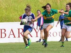 Waterford's Emma Murray is held up by Kerry's Amanda Brosnan