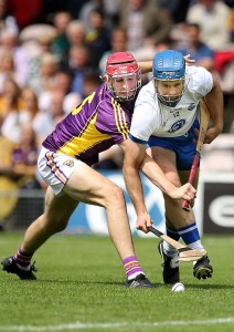 Waterford's Michael Walsh and Wexford's Paudie Foley tussle for possession during last year's All-Ireland SHC Quarter-Final in Thurles. See Sport 2-5 for more.  | Photo: Noel Browne