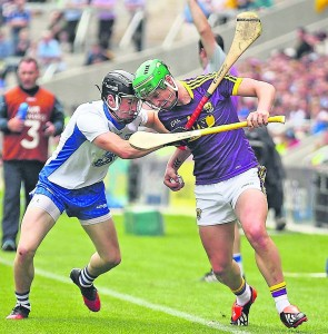 Waterford's Conor Gleeson going head to head with Wexford's Conor McDonald at Páirc Uí Chaoimh during last Sunday's All-Ireland Quarter-Final. See Sport 2-9 for more from Leeside.   Photo: Noel Browne