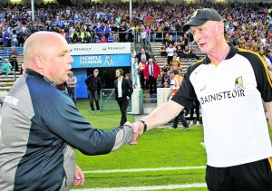 Derek McGrath shakes hands with Brian Cody following Saturday night's final whistle.