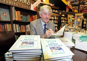 Sign here, please: Tom Hunt pictured signing 'The Little Book of Irish Athletics' following its launch at the Book Centre in Waterford. | Photos: Noel Browne