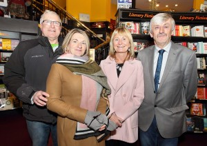 Paul and Catriona O'Callaghan (great grand-daughter of Maurice Davin) pictured with author Tom Hunt and his wife Mary at the launch of The Little Book of Irish Athletics at the Book Centre.