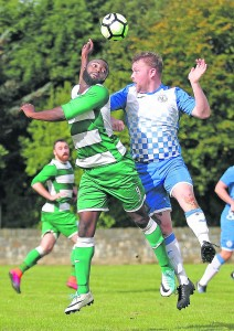 Ferrybank hat-trick hero Meschac Babatu in action for his side against Matthew Billingham of Hibernians in the premier league game between the sides