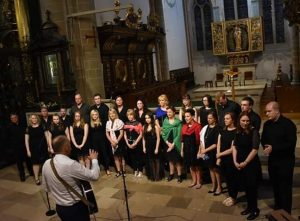 the Choir performing at Holy Cross Cistercian Abbey in Krakow during their visit.