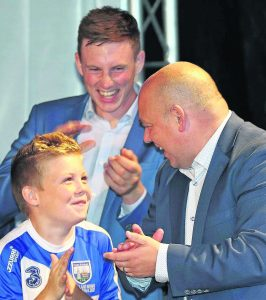 Waterford senior hurling manager Derek McGrath with his son Fionn (and Austin Gleeson in the background) on stage at last Monday's magnificent homecoming on The Quay.
