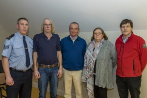 Sgt Alan Kissane, Albert Kearns, Jay Dowdall, Sue McDonagh and Eoghan Power pictured at last week's meeting of the High Road/Ballyduff Community Alert group in Ballyduff Community Centre.