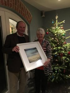 John Galloway (representing the Copper Coast Forum) makes a presentation of a beautiful painting to Cathy Maitland who accepted on behalf of Woodhouse Estate, Stradbally.