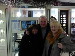 Issy Kennedy and Caroline Butler pictured with former Taoiseach Bertie Ahern during their visit to Newbridge