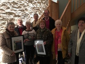 Members of Stradbally Tidy Towns proudly displaying their accolades.