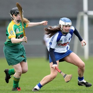 Waterford's Kate Lynch sidesteps away from Meath's Louise Donoghue.