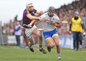 Waterford's Maurice Shanahan tussles with Wexford's Liam Ryan.