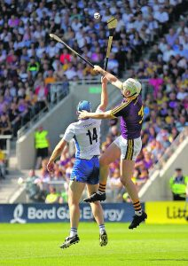 Michael 'Brick' Walsh gets out in front of Wexford's Liam Ryan during last July's All-Ireland Quarter-Final at Páirc Uí Chaoimh.