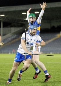 Waterford's Colin Dunford takes man, ball and hurley forward against Tipperary's Paudie Feehan at Semple Stadium on Saturday last. See Sport 2-4 for more. | Photo: Noel Browne
