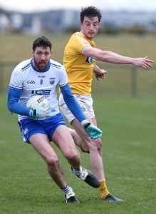 Waterford's Tommy Prendergast is challenged by Antrim's Niall McKeever at the WIT Arena on Sunday last.  | Photos: Maurice Hennebry