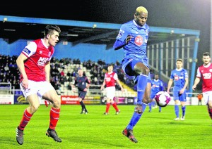 Waterford FC's Izzy Akinade in control.