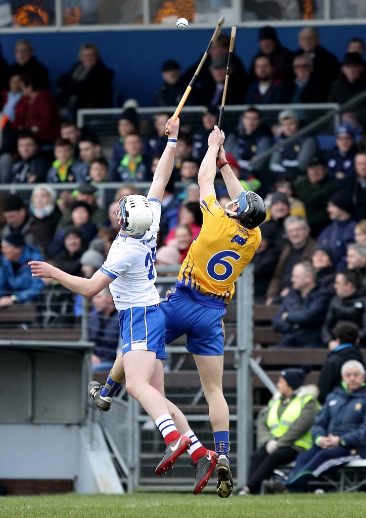 Stephen Bennett and Clare's David McInerney contest a high ball during last Sunday's NHL match at Walsh Park, a fixture which is likely to have been the last inter-county hurling match played in the ground's current guise. 								| Photos: Noel Browne