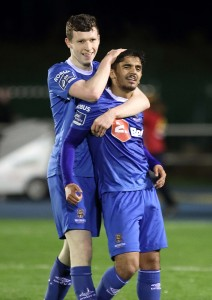 Waterford FC's Faysel Kasmi is congratulated by team mate Dean Walsh after scoring his second goal and his side's third goal of the game against Bray Wanderers. Inset: Faysel Kasmi looking happy after scoring his second goal of the game in the dying minutes of last Friday night's game. | Photo: Noel Browne