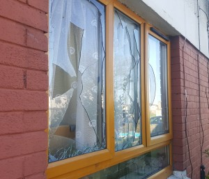 The broken sitting room windows at the home of Ardmore Park resident Favour Ajah.