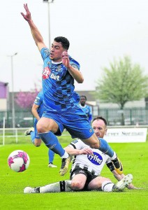 Waterford FC's Courtney Duffus is tackled by Dundalk captain, Stephen O'Donnell