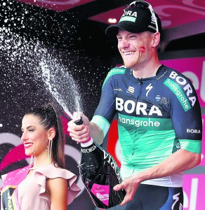 The spoils of victory: Sam Bennett savours his stage seven victory in the Giro D'Italia on Friday last.