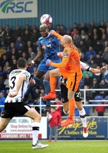 Waterford FC's Izzy Akinade out jumps Dundalk goalkeeper Gary Rogers at the RSC on Friday last week in what was his first league goal for the club