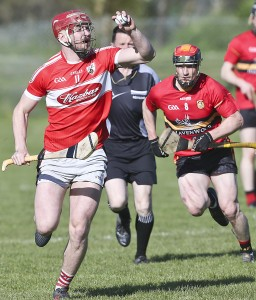 Ballyduff's Jack Lyons steers away from Dunhill's Eamonn Murphy