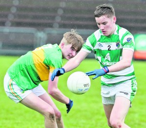 Ballinacourty's David Montgomery turns inside Gaultier's Darragh O'Keeffe during Sunday's JJ Kavanagh & Sons County Under-21 Football Final at Walsh Park.