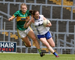 Waterford's Karen McGrath is held up by Kerry's Eilis O'Leary during the Munster Ladies Football Semi-Final at Fitzgerald Stadium on Sunday last. 	 | Photos: Dan McGrath