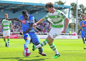 Waterford FC's Izzy Akinade is tackled by Shamrock Rovers Sam Bone.