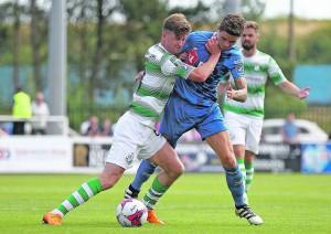 . Shamrock Rovers Ronan Finn fouling Waterford FC's Gavan Holohan in the first half.