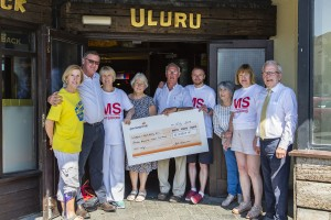 John Brennan of the Uluru presenting proceeds from the Malin Head to Waterford cycle to members of the Waterford and South Kilkenny branch of MS Ireland. Pictured L-R are: Anne Donnelly, John Brennan (Uluru), Eileen Nolan, Francis and Michael Brennan, Lukasz Badziag, Máire Morrissey, Catherine Quinlan and Patrick Blewitt (The Munster Express). Photo: Mick Wall.
