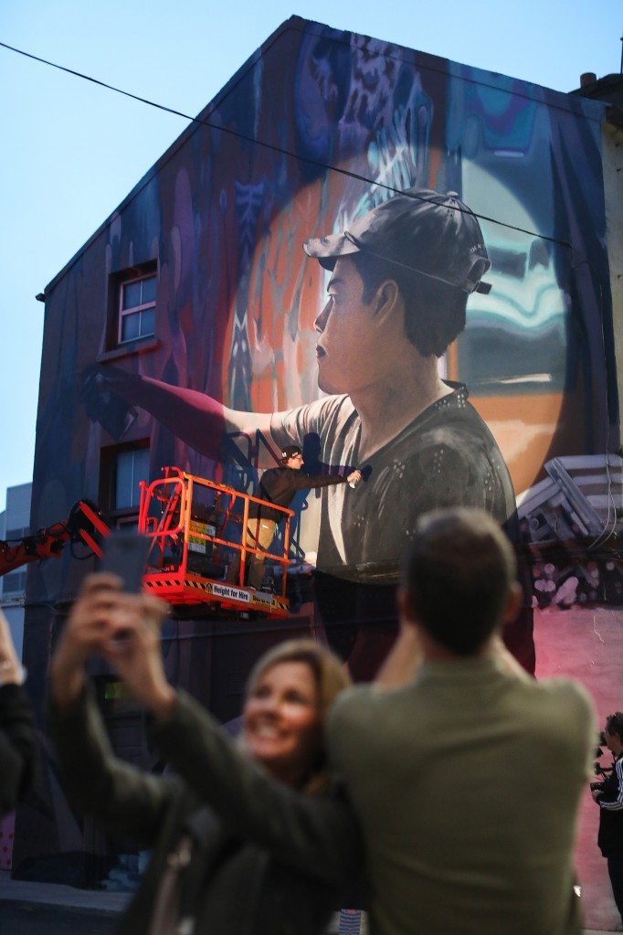 Artist 'Mantra', (kindly sponsored by the French Embassy in Ireland), putting the finishing touches on his piece on the Michael Street/New Street/Apple Market junction during last weeks' 'Waterford Walls' Festival.  				| Photo: Julien Behal
