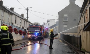 Firefighters tackling the aftermath of last Saturday's blaze. | Photo: Jim O'Sullivan