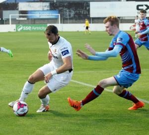 Noel Hunt attempts to jink past the Drogheda defence.