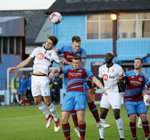 An aerial tussle during last Friday's cup tie.