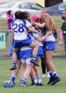 Waterford's players celebrate their historic Munster Minor 'A' Camogie title win over Cork at Fermoy on Wednesday last.