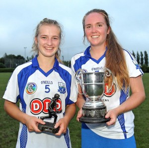 Player of the Match Kate Lynch and Deise skipper Shauna Fitzgerald show off the spoils of victory
