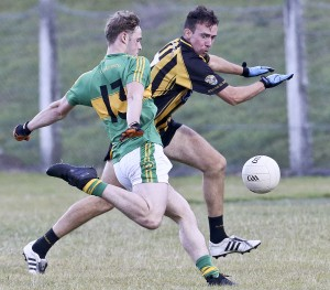 Kilrossanty's Josh Kay gets in his shot despite the best efforts of the Brickeys' Phillip Walsh during the Senior Football Quarter-Final Play-Off at Fraher Field on Sunday last. | Photos: Sean Byrne