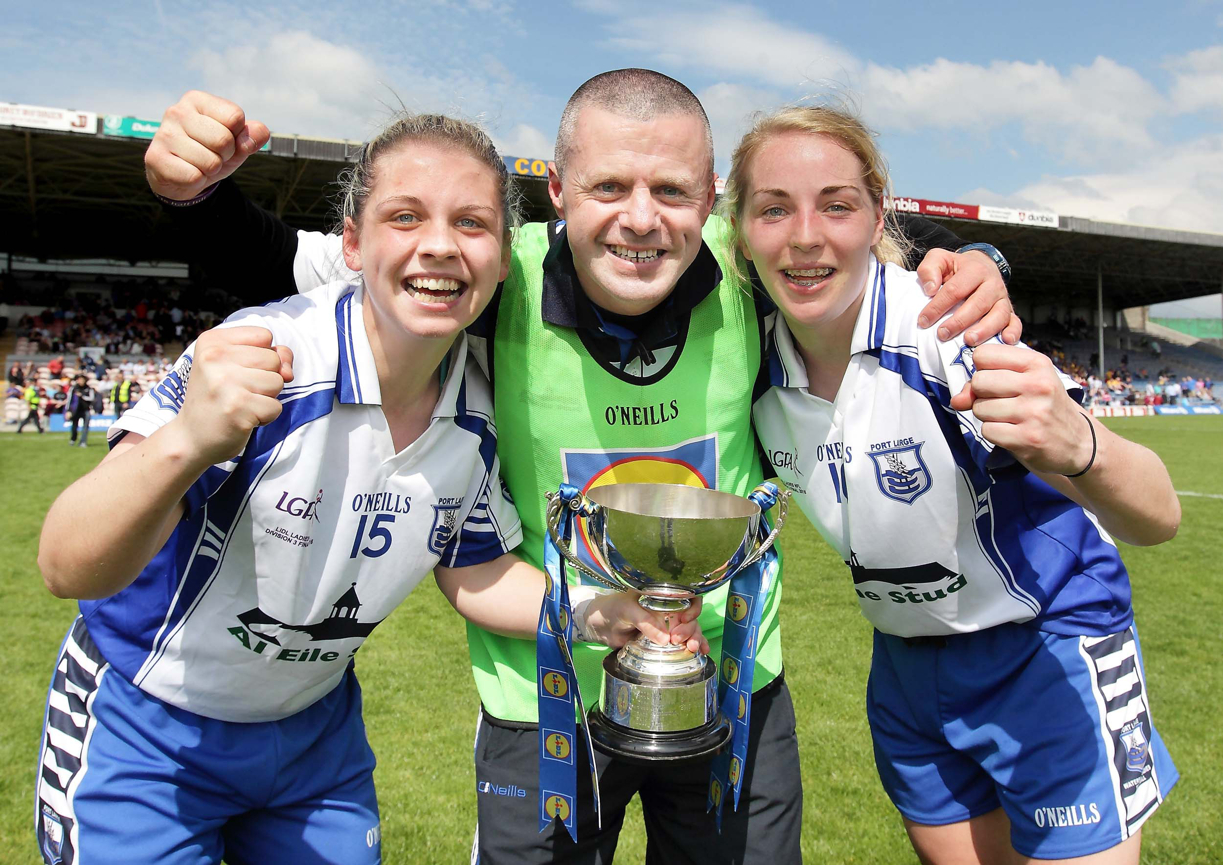 Trophy winning times: Waterford manager Pat Sullivan pictured with Deise skipper Sinéad Ryan and match winner Maria Delahunty following their 2016 Division Three League Final win in Thurles.  | Photo: Noel Browne
