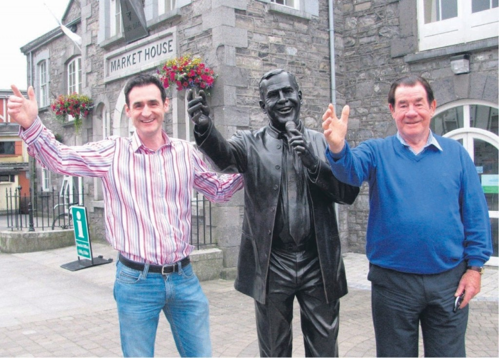 Joe Dolan's nephew, Adrian, and older brother, Ben, at the singer's statue in Mullingar.
