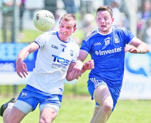 Last time out: Waterford's James McGrath tussles with Monaghan's Conor McManus during the All-Ireland Senior Football Qualifier at Fraher Field.