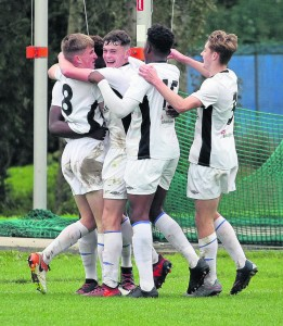 Jack O'Donnell (No 8) mobbed by team mayes after scoring the winner for the Blues U19's against Cabinteely at the RSC last Saturday.