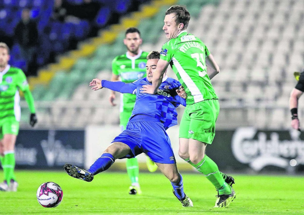 Waterford FC's Cory Galvin tackles Limerick FC's Aaron Fitzgerald.