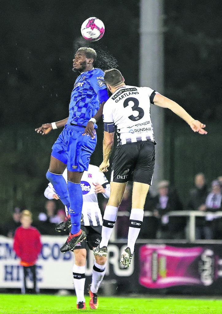 Waterford FC's Izzy Akinade beats Dundalk's Brian Gartland in the air.