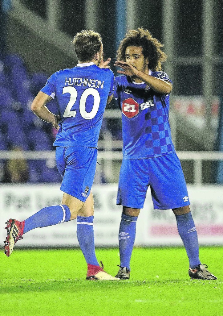 Waterford FC's Bastien Hery congratulates goal scorer Dessie Hutchinson after his goal late in the game for the Blues against Dundalk last Friday Photo: Noel Browne