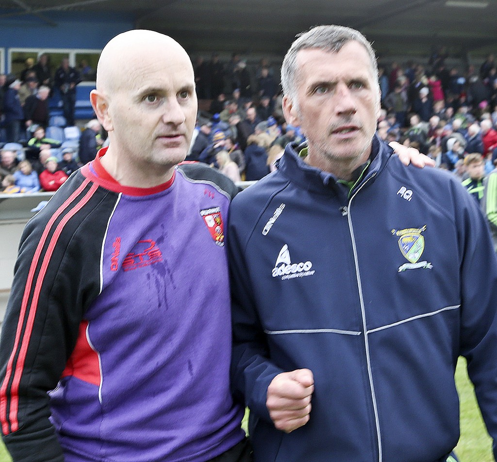 Managers Fergal Hartley and Peter Queally exchange pleasantries following the full-time whistle at Fraher Field.| Photos: Sean Byrne