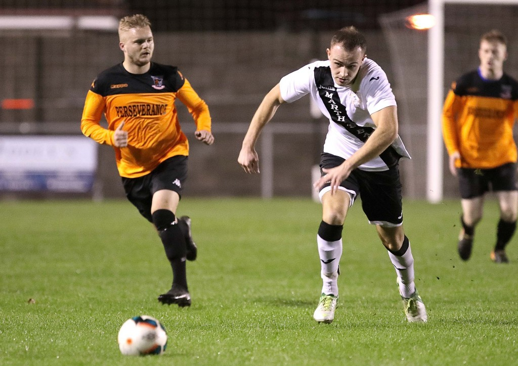 Tramore's Conor McGough in control against Southend's Glen Hawe.