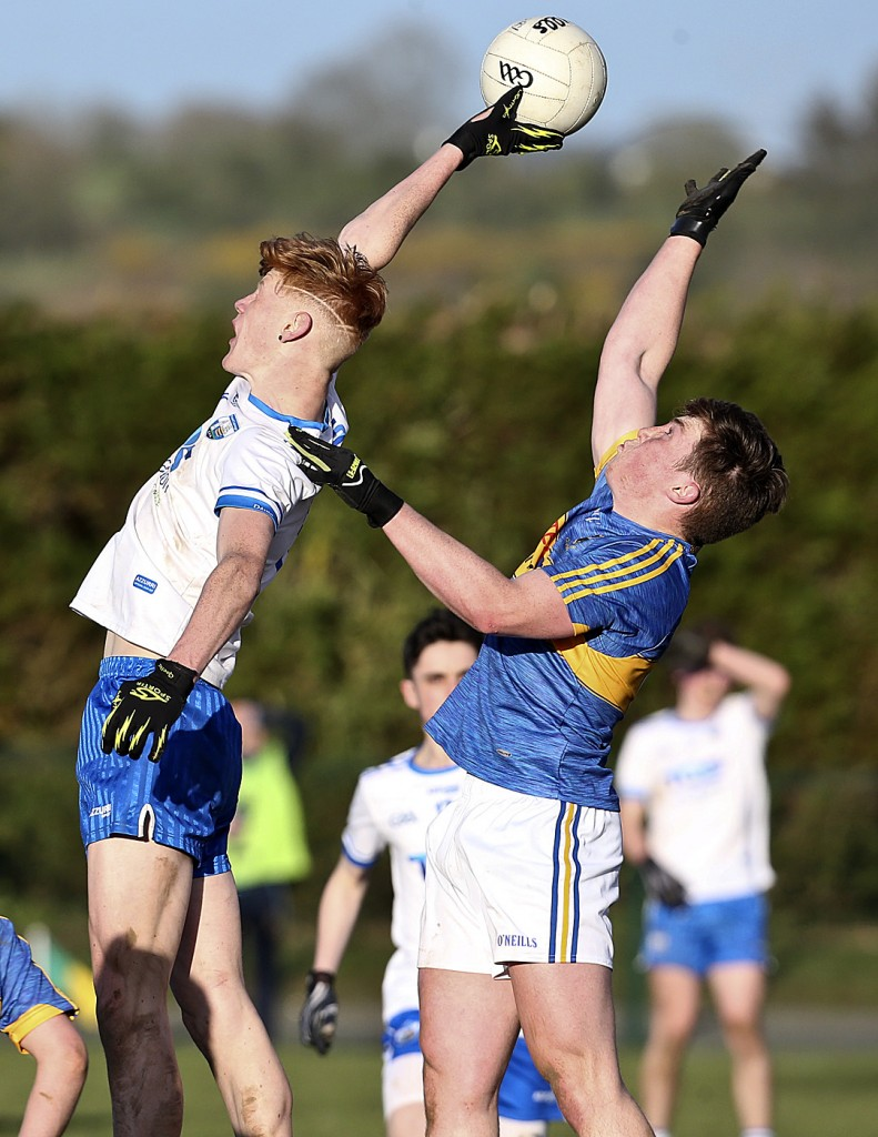 Waterford's Larry Walsh in an aerial duel with Tipperary's Gavin Meagher during last year's  Munster Minor Football play-off match in Lemybrien. The 2019 Deise minors are currently without management following last week's upheaval. 		| Photo: Sean Byrne